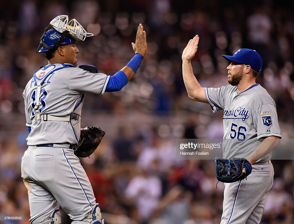 Salvador Perez #13 and Greg Holland #56 of the Kansas City Royals celebrate a win of the game against the Minnesota Twins on June 8, 2015 at Target Field in Minneapolis, Minnesota. The Royals defeated the Twins 3-1.