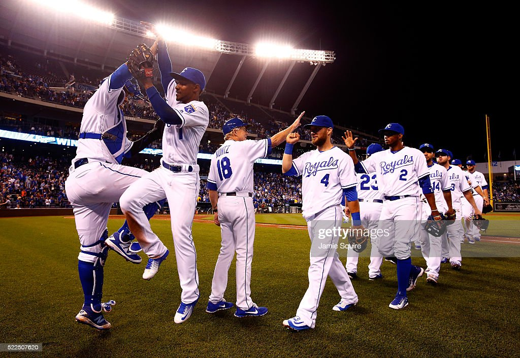Salvador Perez #13 and <a gi-track='captionPersonalityLinkClicked' href=/galleries/search?phrase=Jarrod+Dyson&family=editorial&specificpeople=6780110 ng-click='$event.stopPropagation()'>Jarrod Dyson</a> #1 of the Kansas City Royals high five as the rest of the team celebrates on the field after the Royals defeated the Detroit Tigers 8-6 to win the game at Kauffman Stadium on April 19, 2016 in Kansas City, Missouri.