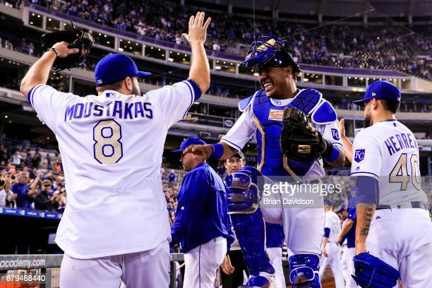 Salvador Perez and Mike Moustakas of the Kansas City Royals celebrate defeating the Cleveland Indians 31 at Kauffman Stadium on May 5 2017 in Kansas...