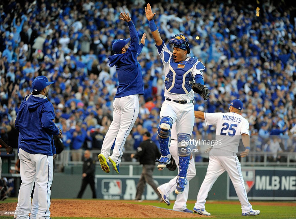 Salvador Perez #13 and <a gi-track='captionPersonalityLinkClicked' href=/galleries/search?phrase=Tim+Collins+-+Baseball&family=editorial&specificpeople=8616741 ng-click='$event.stopPropagation()'>Tim Collins</a> of the Kansas City Royals celebrate after defeating the Houston Astros in game two of the American League Division Series at Kauffman Stadium on October 9, 2015 in Kansas City, Missouri. The Royals defeated the Astros with a score of 5 to 4.