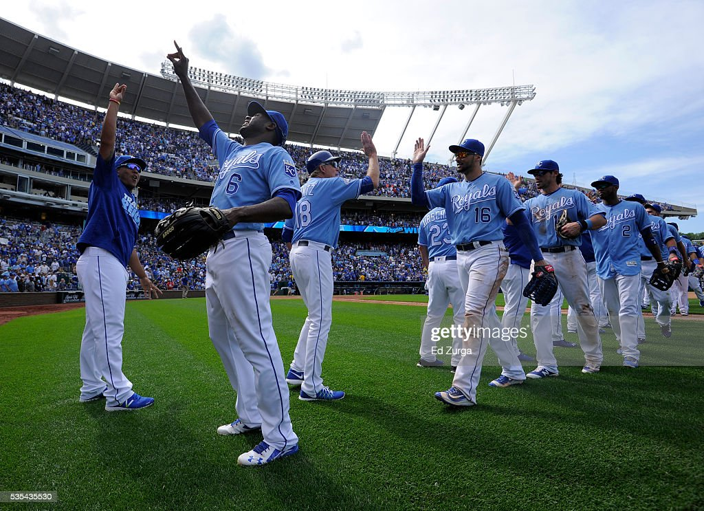 Salvador Perez #13, Lorenzo Cain #6 and members of the Kansas City Royals celebrate a 5-4 win over the Chicago White Sox at Kauffman Stadium on May 29, 2016 in Kansas City, Missouri.