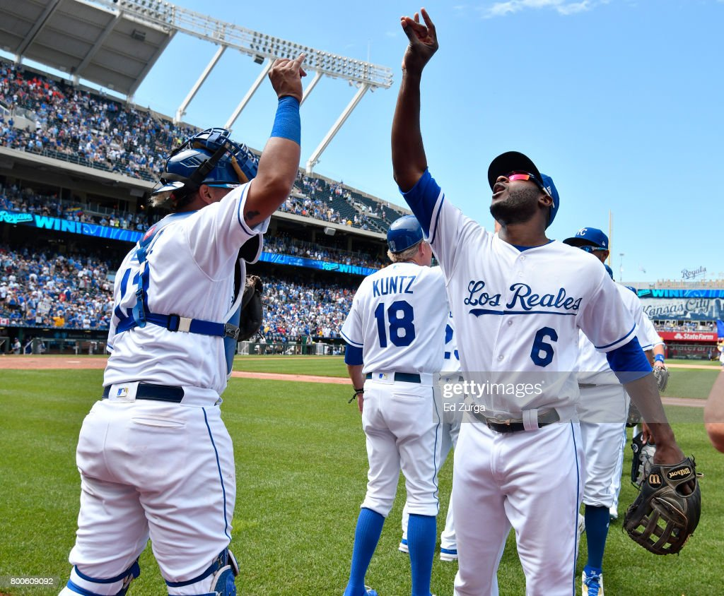 Salvador Perez #13 of the Kansas City Royals and Lorenzo Cain #6 celebrate a 3-2 win over the Toronto Blue Jays at Kauffman Stadium on June 24, 2017 in Kansas City, Missouri.