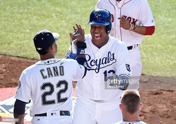 Salvador Perez of the Kansas City Royals and the American League is congratulated by Robinson Cano of the Seattle Mariners after hitting a home run...