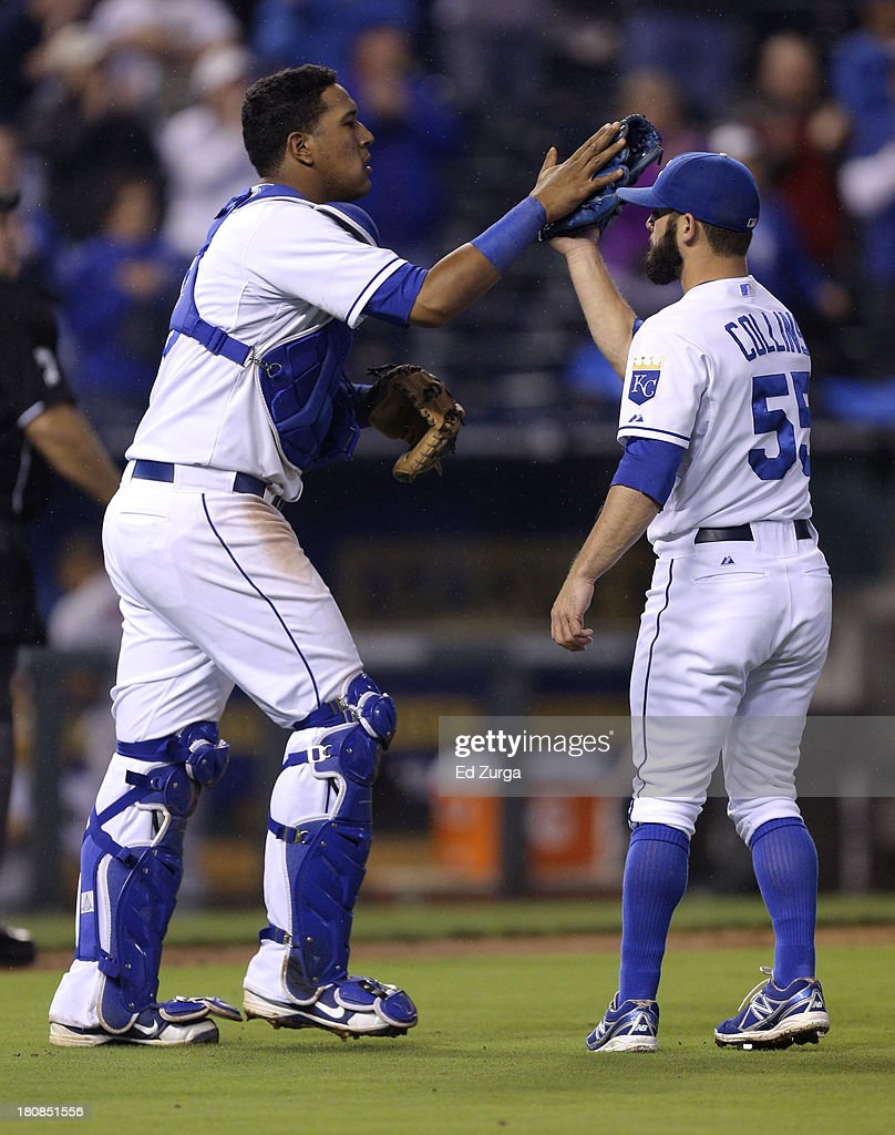 Salvador Perez #13 of the Kansas City Royals and Tim Collins #55 celebrate a 7-1 win over the Cleveland Indians at Kauffman Stadium on September 16, 2013 in Kansas City, Missouri.