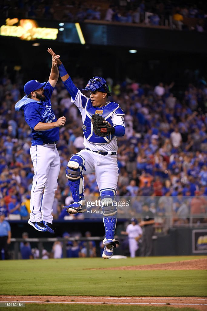 Salvador Perez #13 of the Kansas City Royals and <a gi-track='captionPersonalityLinkClicked' href=/galleries/search?phrase=Tim+Collins+-+Baseball&family=editorial&specificpeople=8616741 ng-click='$event.stopPropagation()'>Tim Collins</a> #55 celebrate a win against the Los Angeles Angels of Anaheim at Kauffman Stadium on August 15, 2015 in Kansas City, Missouri.