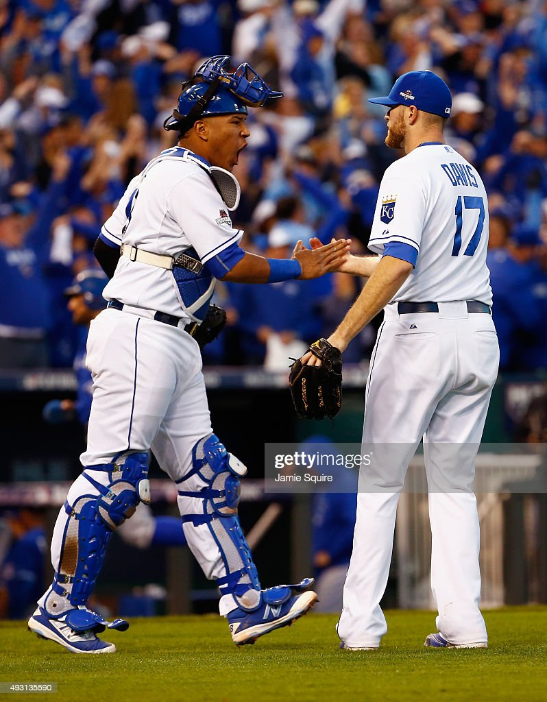 Salvador Perez #13 of the Kansas City Royals and <a gi-track='captionPersonalityLinkClicked' href=/galleries/search?phrase=Wade+Davis+-+Baseball&family=editorial&specificpeople=8202494 ng-click='$event.stopPropagation()'>Wade Davis</a> #17 of the Kansas City Royals celebrate defeating the Toronto Blue Jays 6-3 in game two of the American League Championship Series at Kauffman Stadium on October 17, 2015 in Kansas City, Missouri.