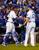 Salvador Perez of the Kansas City Royals and Wade Davis of the Kansas City Royals celebrate defeating the Toronto Blue Jays 63 in game two of the...