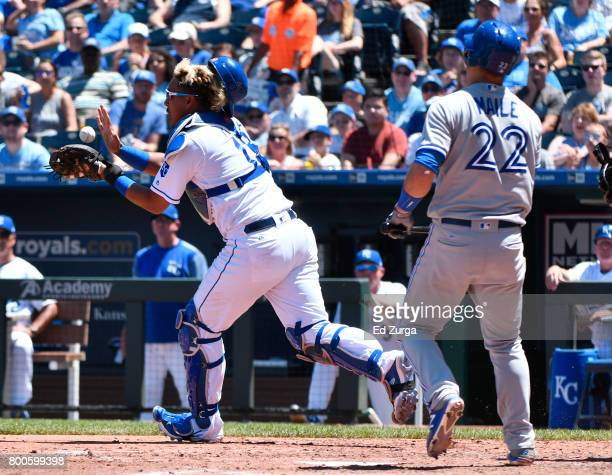 Salvador Perez of the Kansas City Royals catches a ball on a bunt attempt by Luke Maile of the Toronto Blue Jays in the fifth inning at Kauffman...