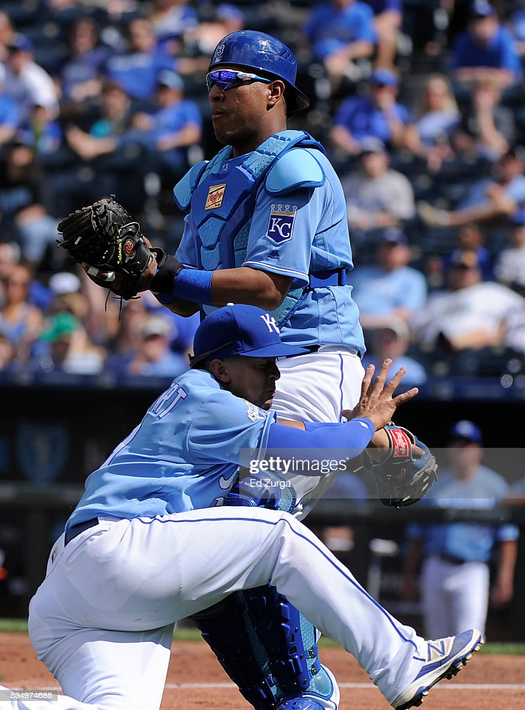 Salvador Perez #13 of the Kansas City Royals catches a foul ball hit by Adam Eaton #1 of the Chicago White Sox as he collides into <a gi-track='captionPersonalityLinkClicked' href=/galleries/search?phrase=Cheslor+Cuthbert&family=editorial&specificpeople=9989117 ng-click='$event.stopPropagation()'>Cheslor Cuthbert</a> #19 in the ninth inning atKauffman Stadium on May 28, 2016 in Kansas City, Missouri. Perez was injured on the play and had to leave the game.