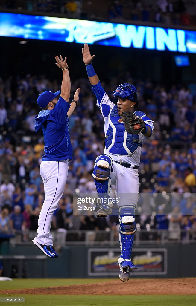 Salvador Perez #13 of the Kansas City Royals celebrates a 3-0 win over the Toronto Blue Jays with <a gi-track='captionPersonalityLinkClicked' href=/galleries/search?phrase=Tim+Collins+-+Baseball&family=editorial&specificpeople=8616741 ng-click='$event.stopPropagation()'>Tim Collins</a> #55 at Kauffman Stadium on July 10, 2015 in Kansas City, Missouri.