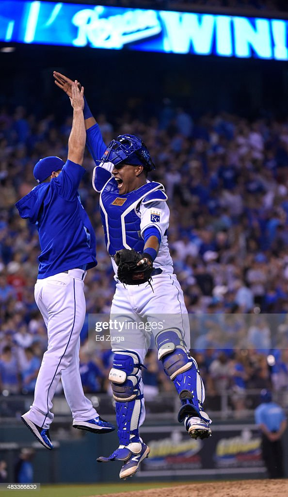 Salvador Perez #13 of the Kansas City Royals celebrates a 3-2 win over the Chicago White Sox with <a gi-track='captionPersonalityLinkClicked' href=/galleries/search?phrase=Tim+Collins+-+Baseball&family=editorial&specificpeople=8616741 ng-click='$event.stopPropagation()'>Tim Collins</a> #55 at Kauffman Stadium on August 7, 2015 in Kansas City, Missouri.