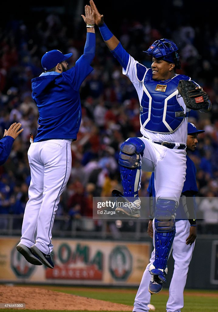 Salvador Perez #13 of the Kansas City Royals celebrates a 5-0 win over the St. Louis Cardinals with <a gi-track='captionPersonalityLinkClicked' href=/galleries/search?phrase=Tim+Collins+-+Baseball&family=editorial&specificpeople=8616741 ng-click='$event.stopPropagation()'>Tim Collins</a> #55 at Kauffman Stadium on May 22, 2015 in Kansas City, Missouri.