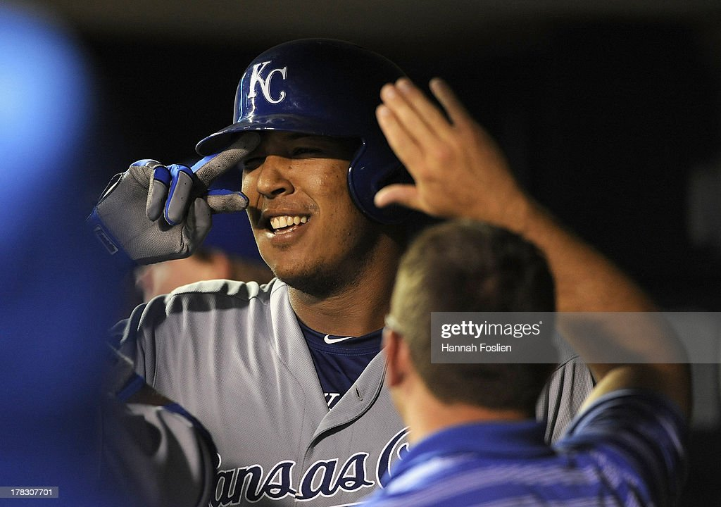 Salvador Perez #13 of the Kansas City Royals celebrates a two run home run against the Minnesota Twins during the eighth inning of the game on August 28, 2013 at Target Field in Minneapolis, Minnesota. The Royals defeated the Twins 8-1.