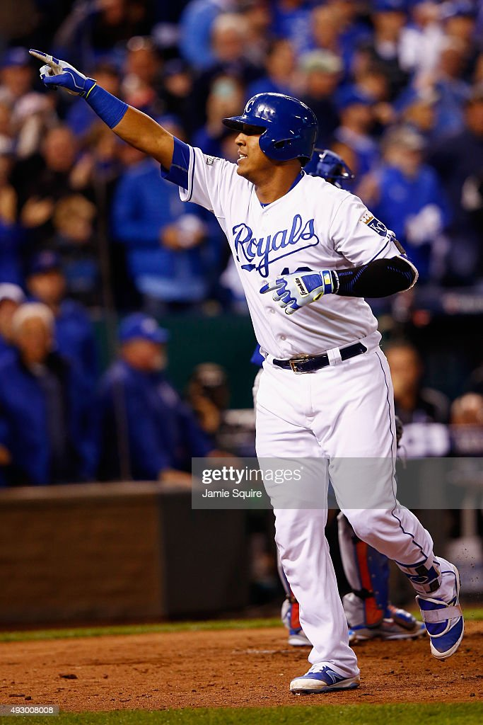 Salvador Perez #13 of the Kansas City Royals celebrates after hitting a solo home run in the fourth inning against the Toronto Blue Jays during game one of the American League Championship Series at Kauffman Stadium on October 16, 2015 in Kansas City, Missouri.