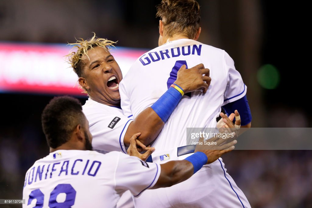Salvador Perez #13 of the Kansas City Royals celebrates with Alex Gordon #4 and Jorge Bonifacio #38 after Gordon's sacrifice fly scored the game-winning run during the bottom of the 9th inning of the game against the Detroit Tigers at Kauffman Stadium on July 19, 2017 in Kansas City, Missouri. The Royals defeated the Tigers with a final score of 4-3.