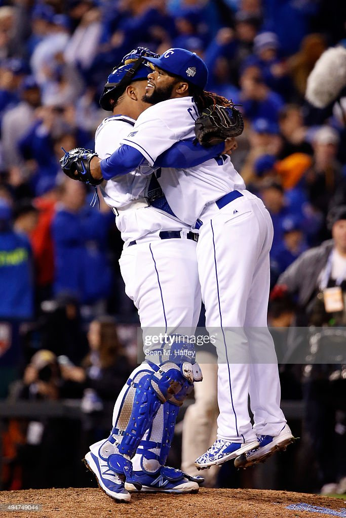 Salvador Perez #13 of the Kansas City Royals celebrates with Johnny Cueto #47 of the Kansas City Royals after defeating the New York Mets 7-1 in Game Two of the 2015 World Series at Kauffman Stadium on October 28, 2015 in Kansas City, Missouri.