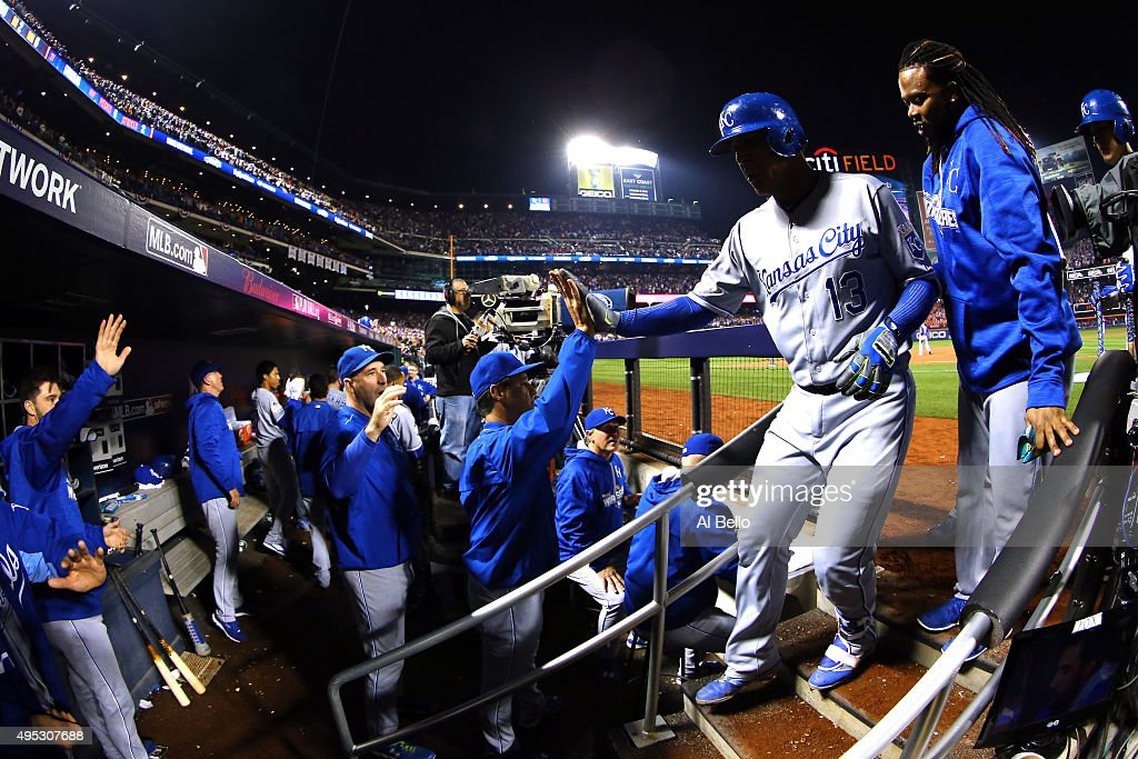 Salvador Perez of the Kansas City Royals celebrates with teammates in the dugout in the ninth inning against the New York Mets during Game Five of...