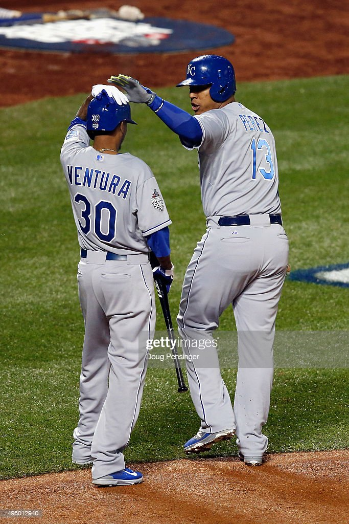 Salvador Perez #13 of the Kansas City Royals celebrates with <a gi-track='captionPersonalityLinkClicked' href=/galleries/search?phrase=Yordano+Ventura&family=editorial&specificpeople=9527243 ng-click='$event.stopPropagation()'>Yordano Ventura</a> #30 after scoring a run in the second inning against the New York Mets during Game Three of the 2015 World Series at Citi Field on October 30, 2015 in the Flushing neighborhood of the Queens borough of New York City.
