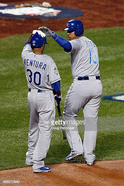 Salvador Perez of the Kansas City Royals celebrates with Yordano Ventura after scoring a run in the second inning against the New York Mets during...