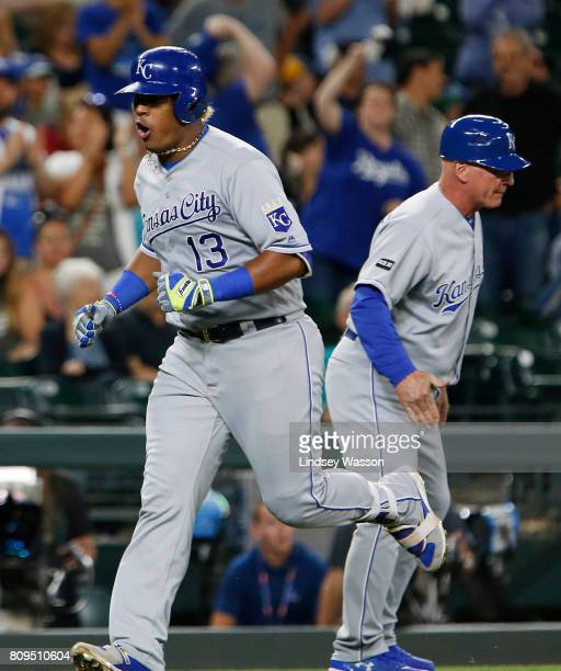 Salvador Perez of the Kansas City Royals cheers as he heads home after hitting a two run home run off of James Pazos of the Seattle Mariners in the...