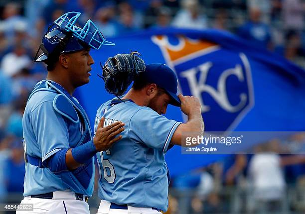 Salvador Perez of the Kansas City Royals congratulates closing pitcher Greg Holland after the Royals defeated the Baltimore Orioles 53 to win the...