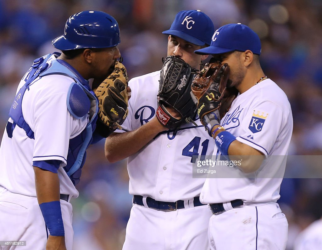 Salvador Perez #13 of the Kansas City Royals, Danny Duffy #41 and Omar Infante #14 have a meeting on the mound in the fifth inning during a game against the Los Angeles Dodgers at Kauffman Stadium on June 24, 2014 in Kansas City, Missouri.