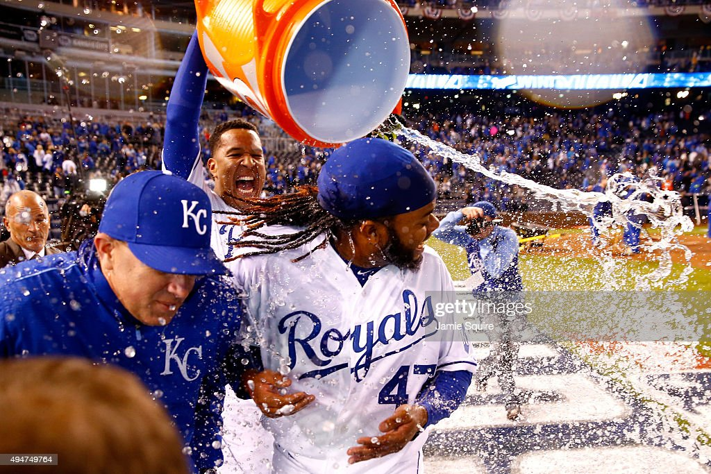 Salvador Perez #13 of the Kansas City Royals douses Johnny Cueto #47 of the Kansas City Royals after defeating the New York Mets 7-1 in Game Two of the 2015 World Series at Kauffman Stadium on October 28, 2015 in Kansas City, Missouri.