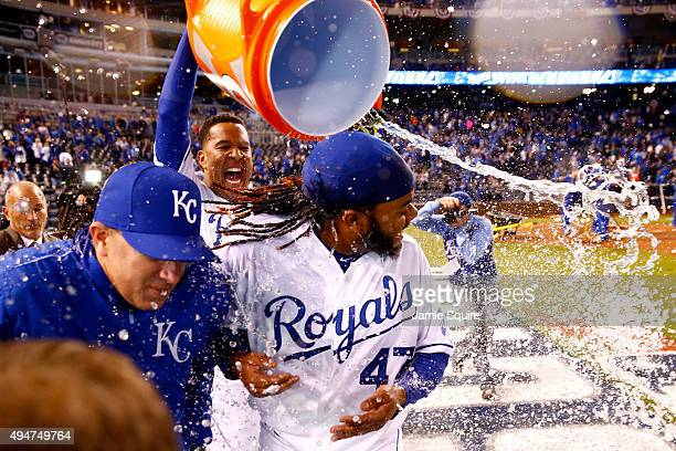 Salvador Perez of the Kansas City Royals douses Johnny Cueto of the Kansas City Royals after defeating the New York Mets 71 in Game Two of the 2015...