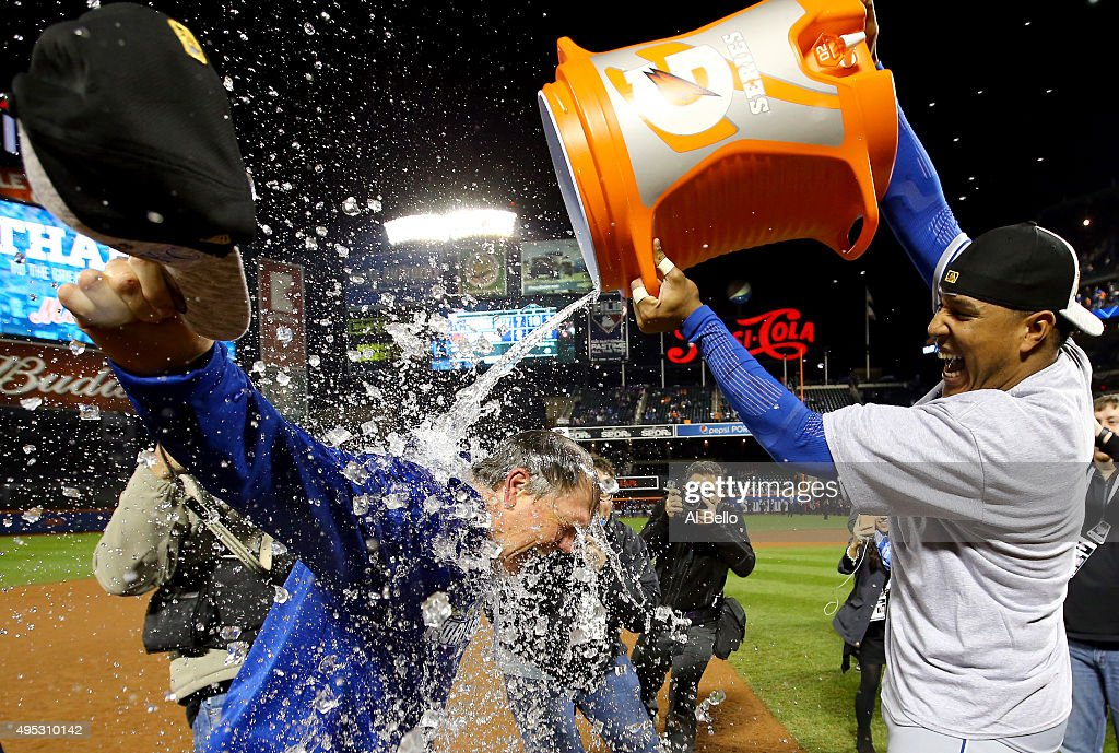 Salvador Perez #13 of the Kansas City Royals douses manager <a gi-track='captionPersonalityLinkClicked' href=/galleries/search?phrase=Ned+Yost&family=editorial&specificpeople=228571 ng-click='$event.stopPropagation()'>Ned Yost</a> #3 of the Kansas City Royals after the Kansas City Royals defeat the New York Mets in Game Five of the 2015 World Series at Citi Field on November 1, 2015 in the Flushing neighborhood of the Queens borough of New York City. The Kansas City Royals defeated the New York Mets with a score of 7 to 2 to win the World Series.
