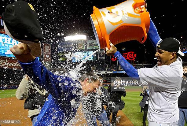 Salvador Perez of the Kansas City Royals douses manager Ned Yost of the Kansas City Royals after the Kansas City Royals defeat the New York Mets in...