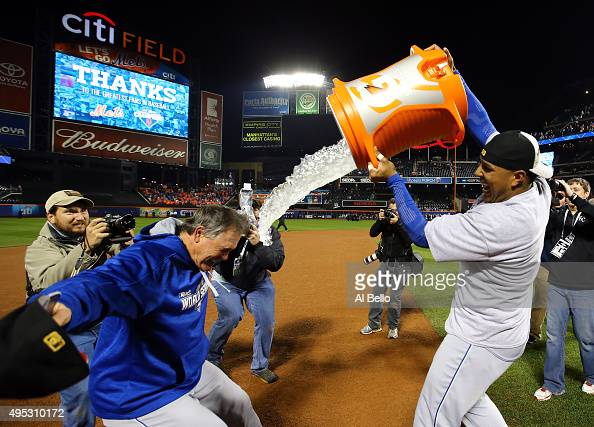 Salvador Perez of the Kansas City Royals douses manager Ned Yost of the Kansas City Royals after the Kansas City Royals defeat the New York Mets in...