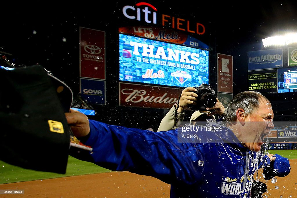 Salvador Perez #13 of the Kansas City Royals (not pictured) douses manager Ned Yost #3 of the Kansas City Royals after the Kansas City Royals defeat the New York Mets in Game Five of the 2015 World Series at Citi Field on November 1, 2015 in the Flushing neighborhood of the Queens borough of New York City. The Kansas City Royals defeated the New York Mets with a score of 7 to 2 to win the World Series.