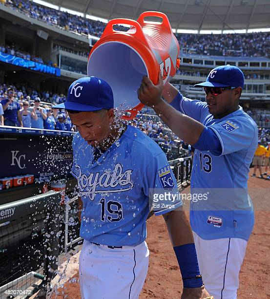 Salvador Perez of the Kansas City Royals dumps water on Cheslor Cuthbert of the Kansas City Royals as they celebrate a 51 win over the Houston Astros...