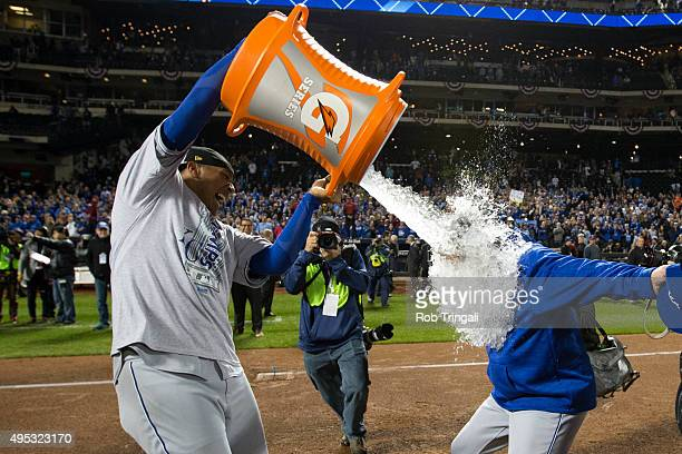 Salvador Perez of the Kansas City Royals gives manager Ned Yost a Gatorade shower after defeating the New York Mets in Game 5 of the 2015 World...