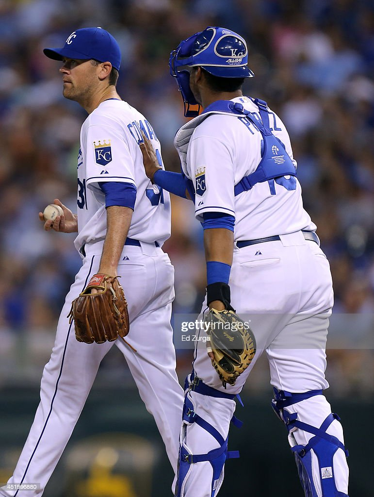 Salvador Perez #13 of the Kansas City Royals goes the mound to talk with pitcher <a gi-track='captionPersonalityLinkClicked' href=/galleries/search?phrase=Louis+Coleman&family=editorial&specificpeople=2145489 ng-click='$event.stopPropagation()'>Louis Coleman</a> #31 in the fifth inning during a game against the Detroit Tigers at Kauffman Stadium on July 10, 2014 at Kauffman Stadium in Kansas City, Missouri.