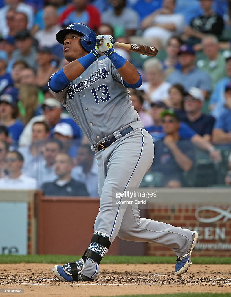 Salvador Perez #13 of the Kansas City Royals hits a solo home run in the 4th inning against the Chicago Cubs at Wrigley Field on May 29, 2015 in Chicago, Illinois.