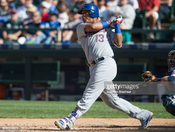 Salvador Perez of the Kansas City Royals hits a tworun double off of starting pitcher Felix Hernandez of the Seattle Mariners that scored Eric Hosmer...