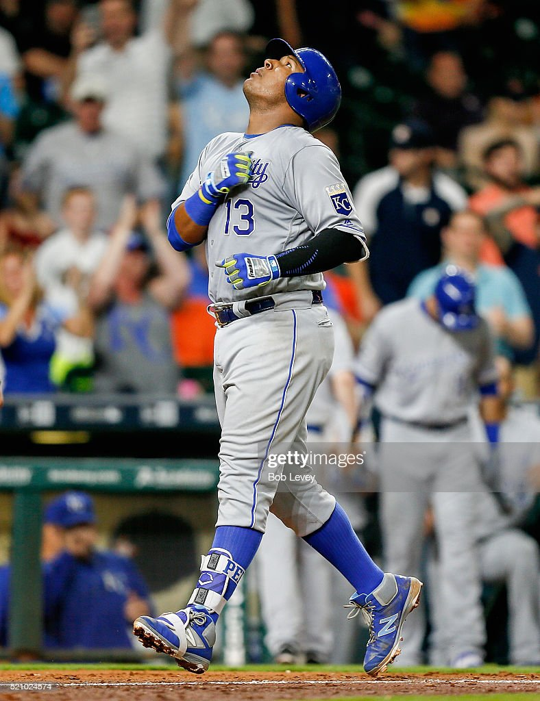 Salvador Perez #13 of the Kansas City Royals hits a two-run home run in the eighth inning against the Houston Astros at Minute Maid Park on April 13, 2016 in Houston, Texas.