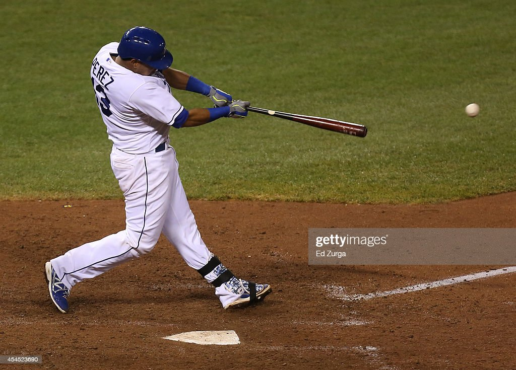 Salvador Perez #13 of the Kansas City Royals hits an RBI single in the eighth inning against the Texas Rangers at Kauffman Stadium on September 2, 2014 in Kansas City, Missouri.