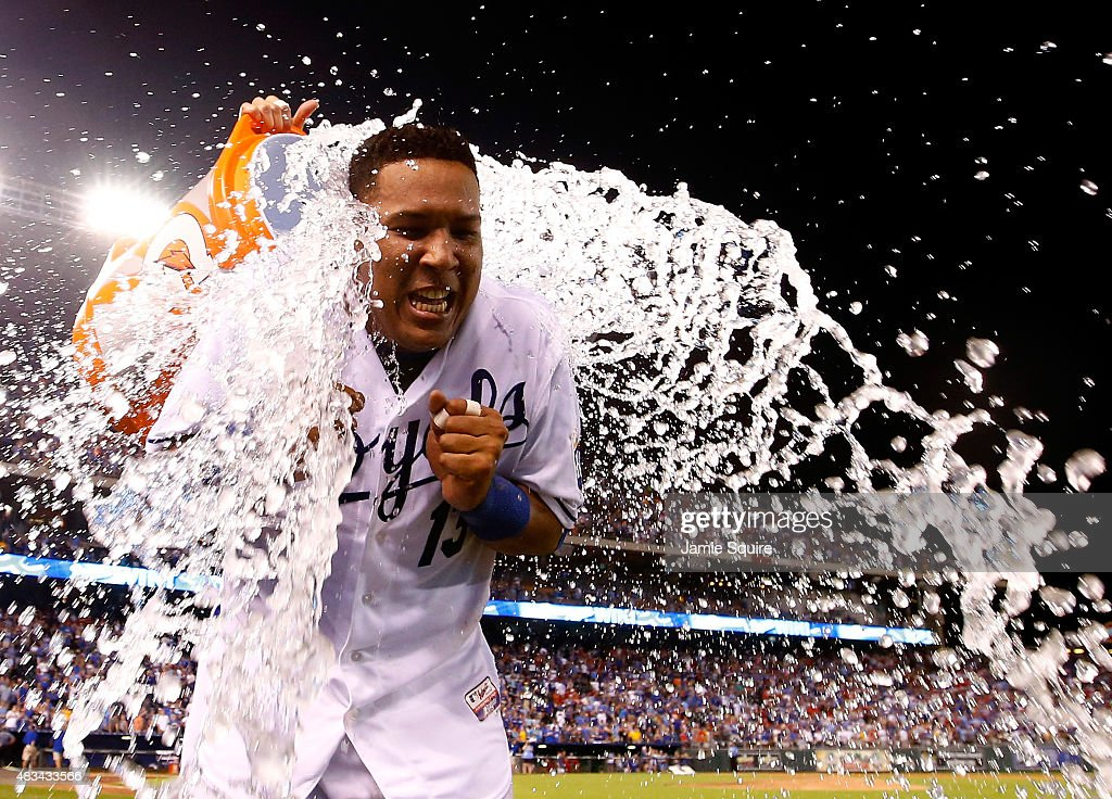 Salvador Perez #13 of the Kansas City Royals is doused with water after the Royals defeated the Chicago White Sox 7-6 to win the game at Kauffman Stadium on August 8, 2015 in Kansas City, Missouri.