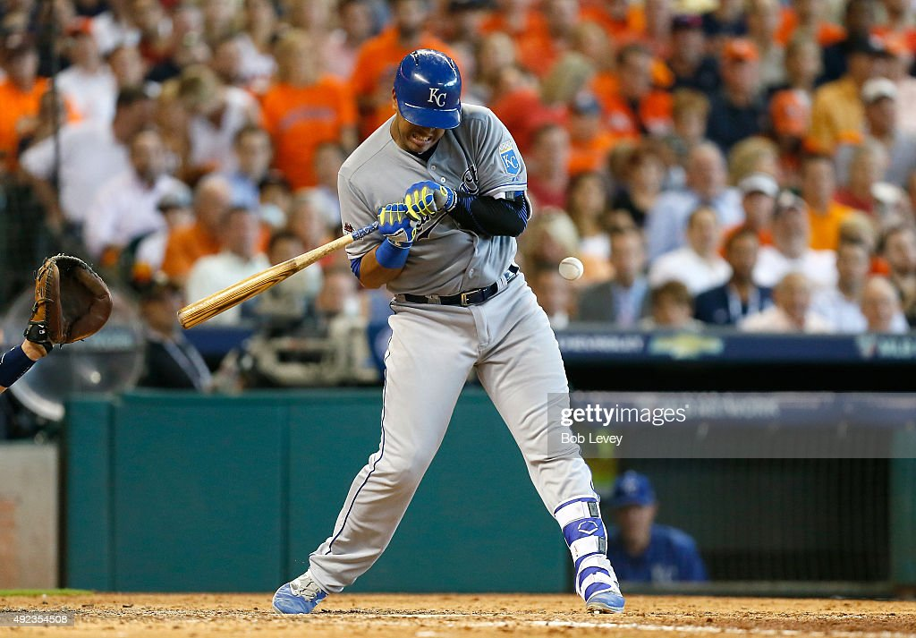 Salvador Perez #13 of the Kansas City Royals is hit by a pitch in the seventh inning against the Houston Astros during game four of the American League Divison Series at Minute Maid Park on October 12, 2015 in Houston, Texas.