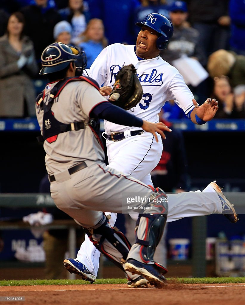 Salvador Perez #13 of the Kansas City Royals is tagged out at home plate by catcher <a gi-track='captionPersonalityLinkClicked' href=/galleries/search?phrase=Kurt+Suzuki&family=editorial&specificpeople=682702 ng-click='$event.stopPropagation()'>Kurt Suzuki</a> #8 of the Minnesota Twins while trying to score during the 2nd inning of the game at Kauffman Stadium on April 20, 2015 in Kansas City, Missouri.