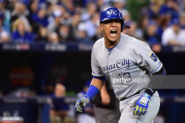 Salvador Perez of the Kansas City Royals reacts after scoring a run in the seventh inning against the Toronto Blue Jays during game four of the...