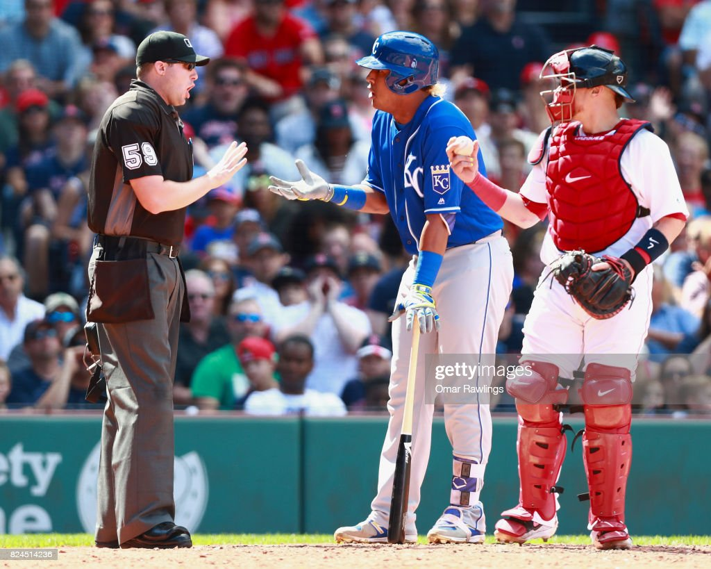 Salvador Perez #13 of the Kansas City Royals reacts to home plate umpire Nic Lentz #59 call in the top of the sixth inning during the game against the Boston Red Sox at Fenway Park on July 30, 2017 in Boston, Massachusetts.
