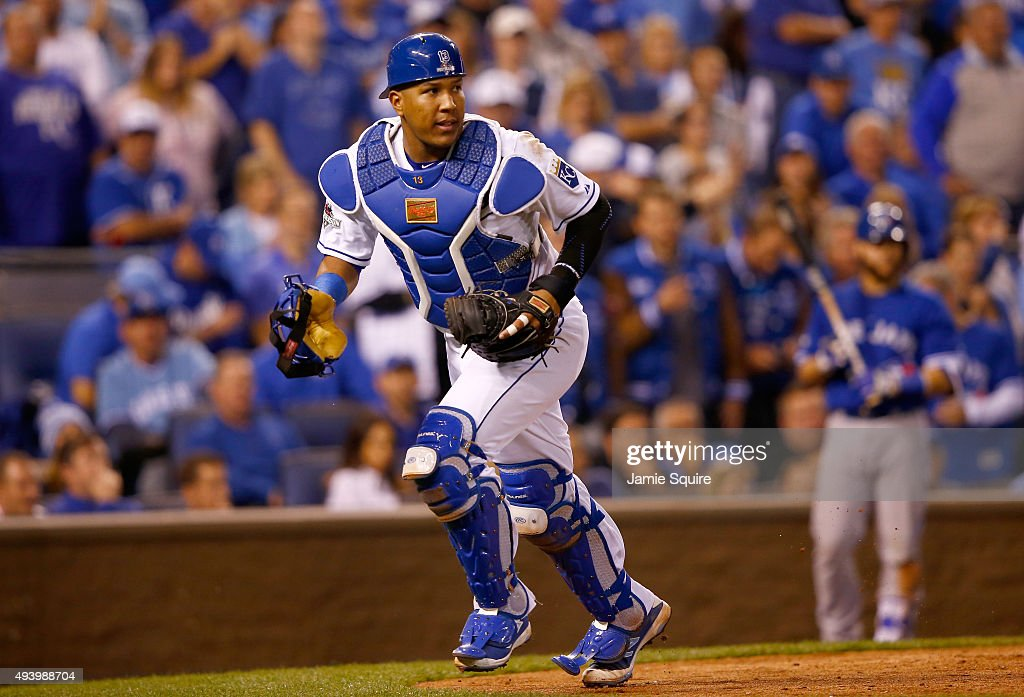 Salvador Perez #13 of the Kansas City Royals runs after a wild pitch in the eighth inning against the Toronto Blue Jays in game six of the 2015 MLB American League Championship Series at Kauffman Stadium on October 23, 2015 in Kansas City, Missouri.