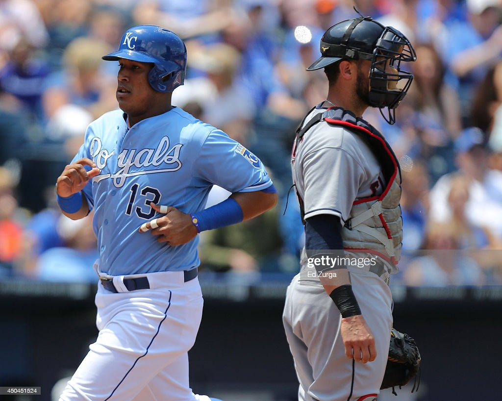 Salvador Perez #13 of the Kansas City Royals runs around <a gi-track='captionPersonalityLinkClicked' href=/galleries/search?phrase=Yan+Gomes&family=editorial&specificpeople=9004037 ng-click='$event.stopPropagation()'>Yan Gomes</a> #10 of the Cleveland Indians as he scores on an Alcides Escobar sacrifice fly in the fourth inning at Kauffman Stadium on June 11, 2014 in Kansas City, Missouri.
