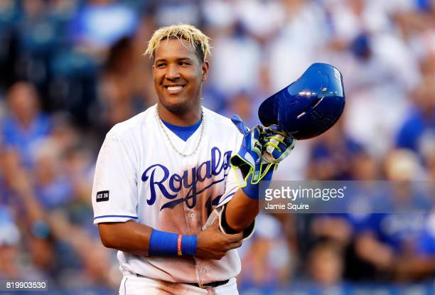 Salvador Perez of the Kansas City Royals smiles toward the dugout after being hit by a pitch during the 3rd inning of the game against the Detroit...