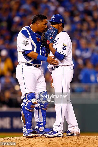 Salvador Perez of the Kansas City Royals speaks with Edinson Volquez of the Kansas City Royals on the pitcher's mound in the sixth inning against the...
