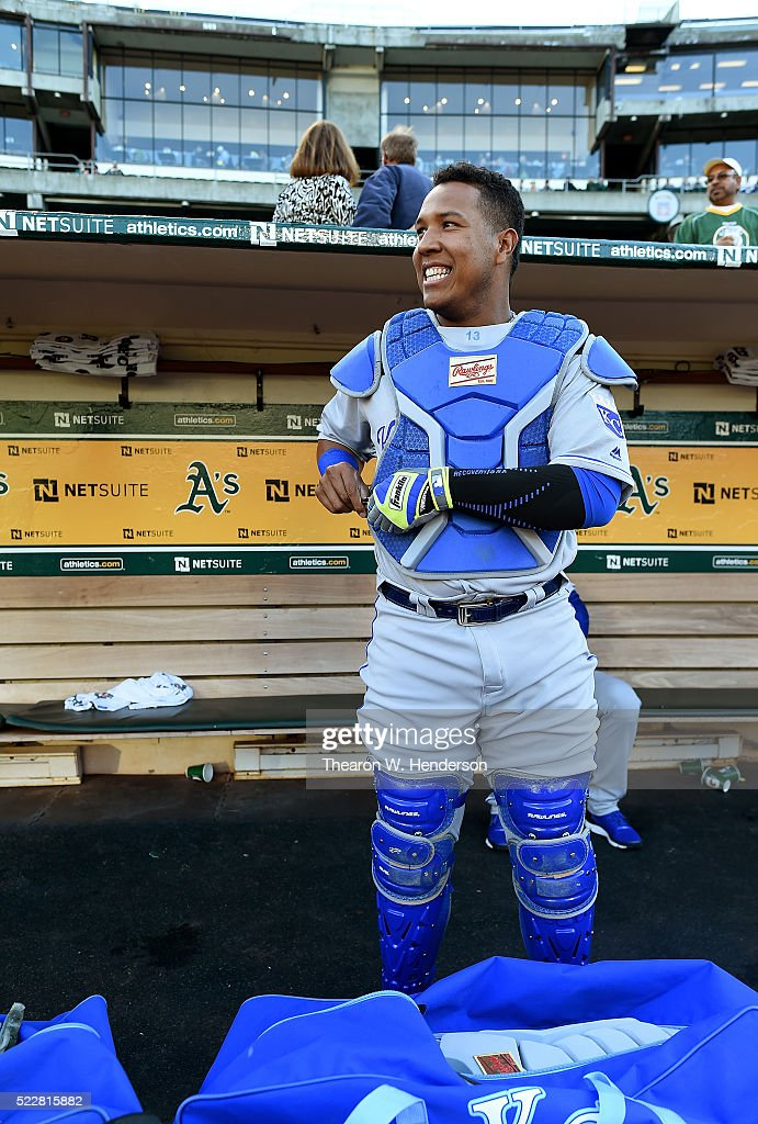 Salvador Perez #13 of the Kansas City Royals stands in the dugout putting on his catchers gear prior to the start of the game against the Oakland Athletics at O.co Coliseum on April 15, 2016 in Oakland, California. All player are wearing #42 in honor of Jackie Robinson Day.