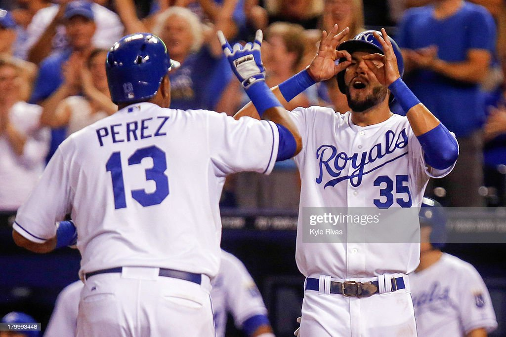 Salvador Perez #13 of the Kansas City Royals touches home plate and celebrates with teammate <a gi-track='captionPersonalityLinkClicked' href=/galleries/search?phrase=Eric+Hosmer&family=editorial&specificpeople=7091345 ng-click='$event.stopPropagation()'>Eric Hosmer</a> #35 after hitting a two-run home run against the Detroit Tigers in the sixth inning on September 7, 2013 at Kauffman Stadium in Kansas City, Missouri.